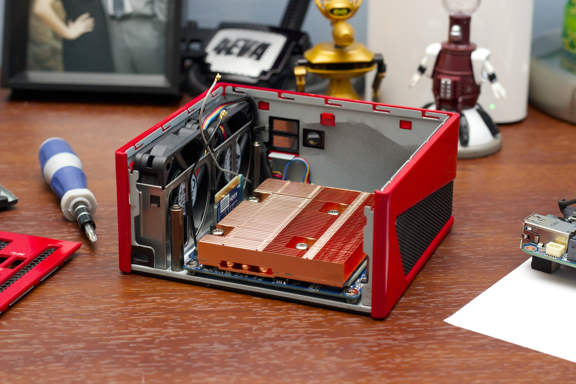The Brix has two system boards on the inside: one with the RAM, SSD, CPU, and other system components on it (right, on edge of frame), and one that houses the GPU and its RAM (shown here under the large heatsink).