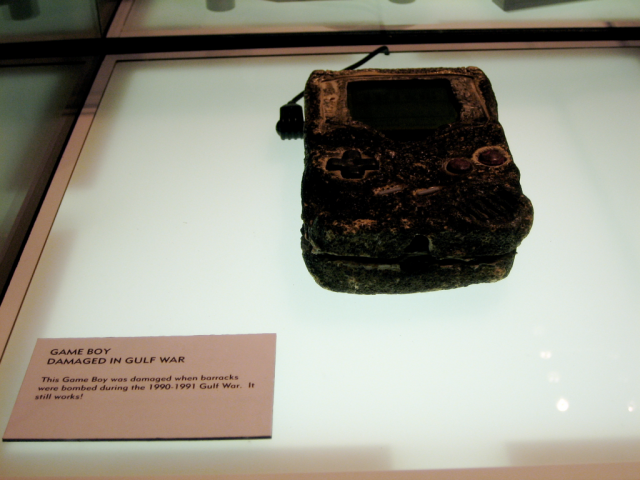 An extremely damaged (but still working) Game Boy now on display at the Nintendo World store in New York City.
