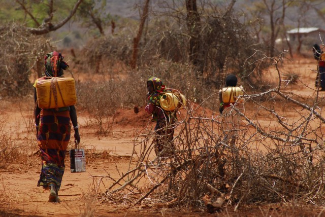 Ethiopians carrying jerrycans of water.