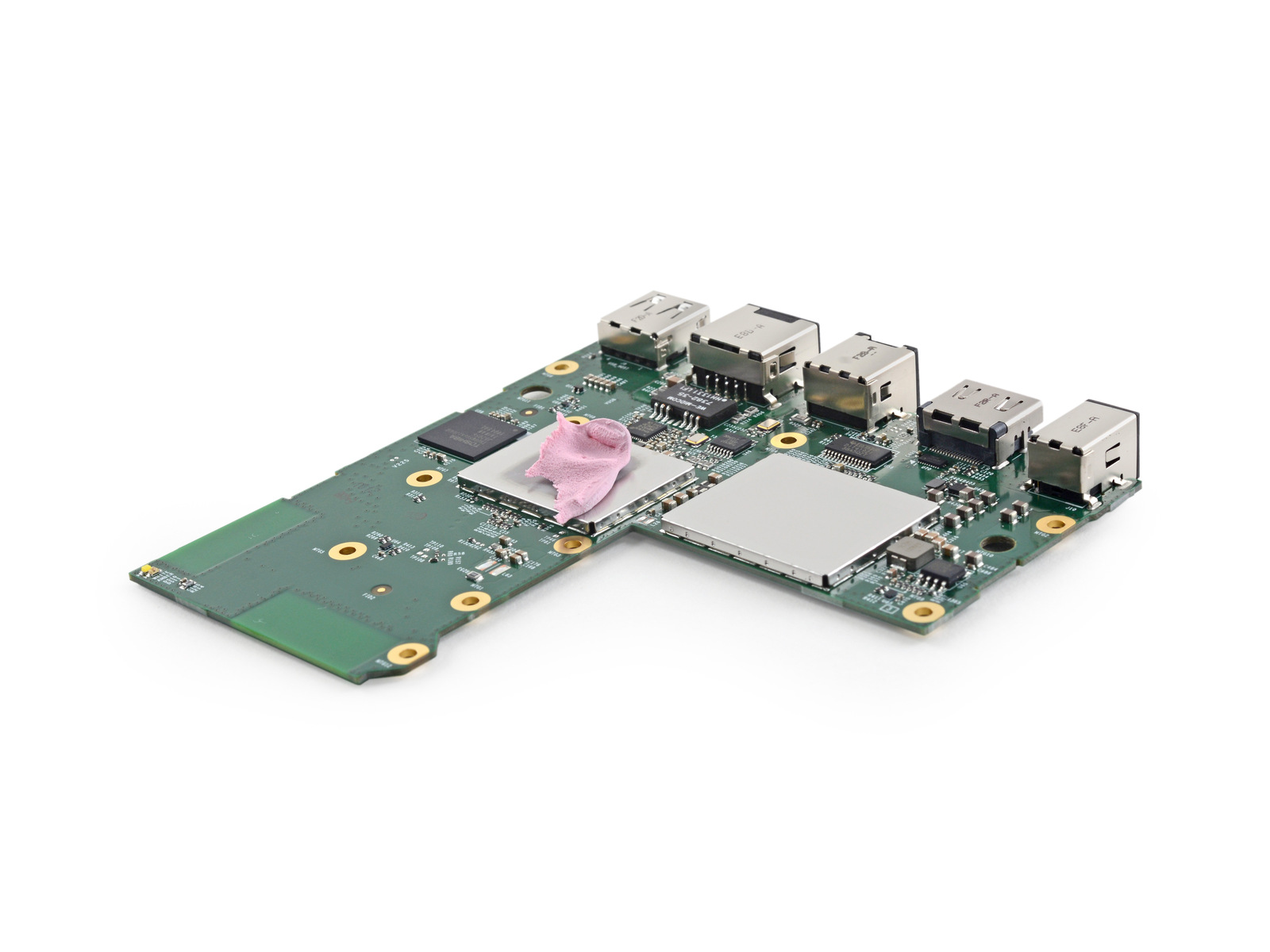 The system board and its bubblegum-pink thermal pad, separated from the Fire TV's large heatsink.
