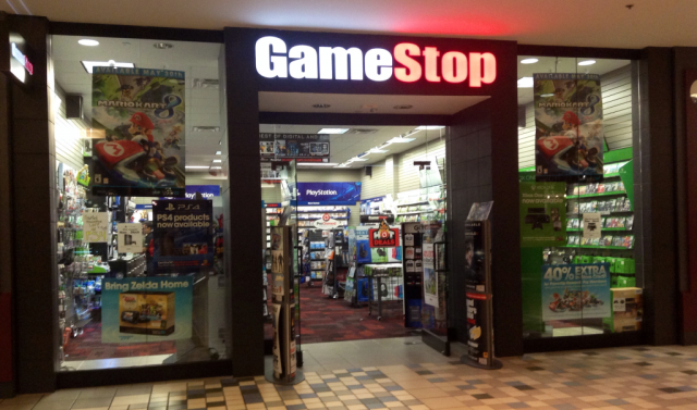 Brightly lit GameStop storefront.