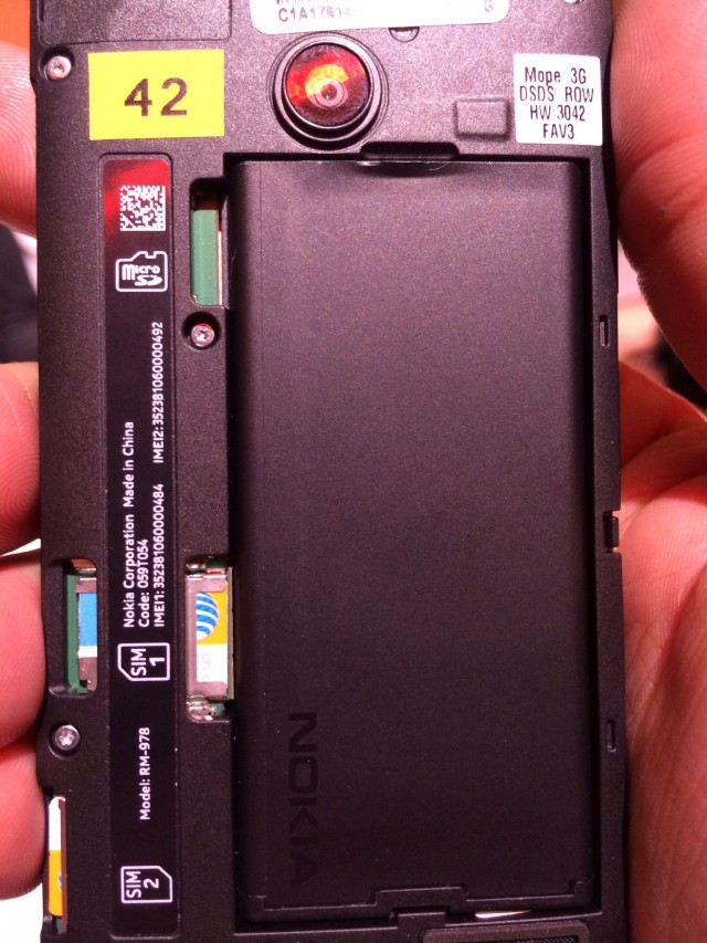 The rear of the Lumia 630 dual-SIM with its back cover removed. Note the battery, SIM, and (upper left) microSD slot.