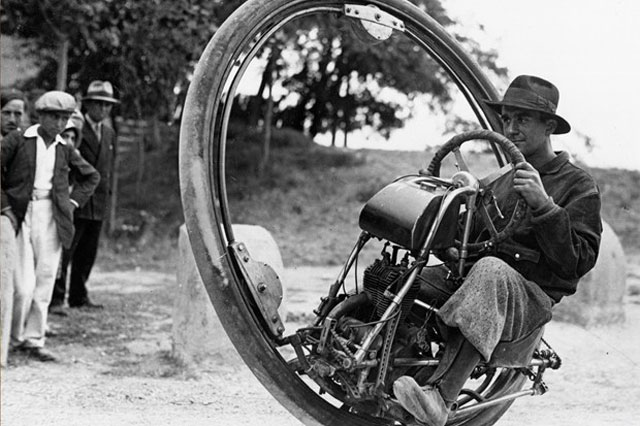 A Swiss engineer known as Mr. Gerdes designed this monowheel. It is pictured here, ridden by a man who may or may not be Mr. Gerdes, apparently on a trip to Spain in 1931.
