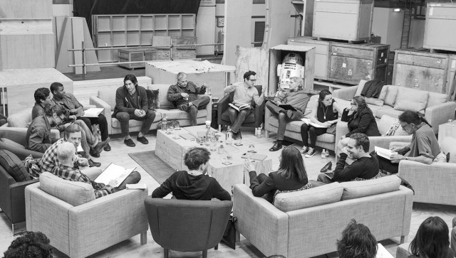 April 29, Pinewood Studios, UK—Writer/Director/Producer JJ Abrams (top center right) at the cast read-through of <i>Star Wars Episode VII</i> at Pinewood Studios with (clockwise from right) Harrison Ford, Daisy Ridley, Carrie Fisher, Peter Mayhew, Producer Bryan Burk, Lucasfilm President and Producer Kathleen Kennedy, Domhnall Gleeson, Anthony Daniels, Mark Hamill, Andy Serkis, Oscar Isaac, John Boyega, Adam Driver, and writer Lawrence Kasdan.
