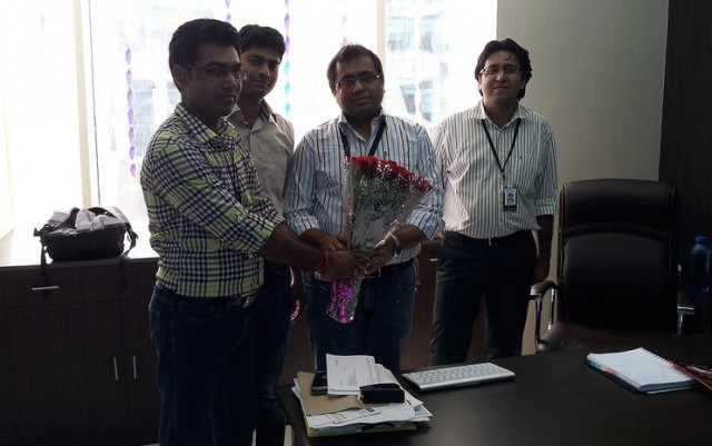 PCCare247 employees presenting flowers to Vikas Agrawal on his birthday.