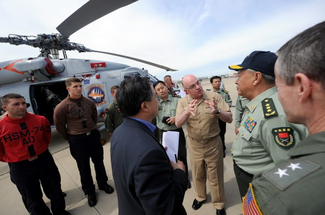 Adm. John C. Harvey Jr., center, commander of U.S. Fleet Forces Command, speaks with Gen. Chen Bingde, Chief of the General Staff of the Republic of China People's Liberation Army, during a tour of Carrier Airborne Early Warning Squadron (VAW) 126.