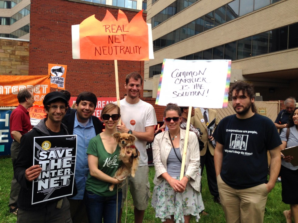 Protesters (including Dr. Chicken Courageous-Xylophone, dog) posing for a photo.