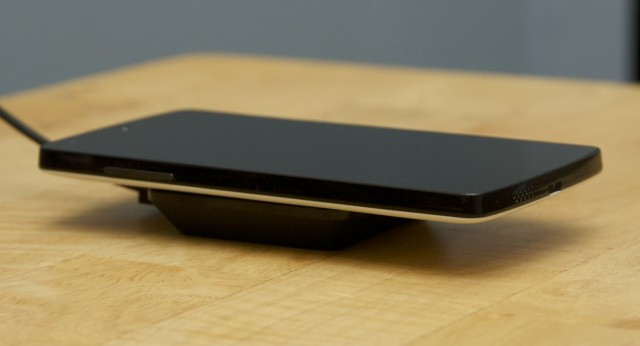 The Nexus 5 charging on the Nexus Wireless Charger pad.