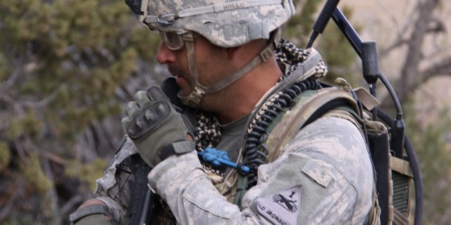 An Army test team member with the AN/PRC-155 Manpack Radio, one of General Dynamics' entries in the JTRS HMS radio program, during testing on May 2 at Ft. Bliss.