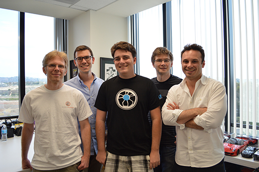 John Carmack (left) poses with Oculus founder Palmer Luckey (center) and other members of the Oculus team.