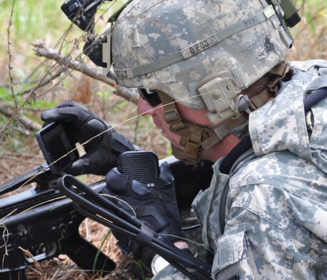 Staff Sgt. Vincent Kelly, of A Company, 1st Battalion, 29th Infantry Regiment, receives real-time imagery using the Small Unit Leader Situational Awareness Tool during a Maneuver Battle Lab demonstration on May 13, 2014, at McKenna Military Operations on Urban Terrain training area at Fort Benning, Georgia.