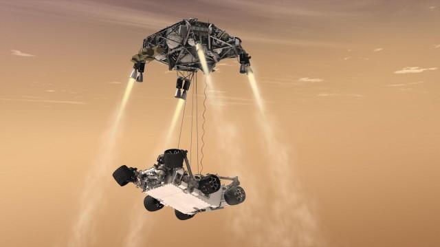 "3D rendering of Curiosity's ""skycrane"" landing on Mars."