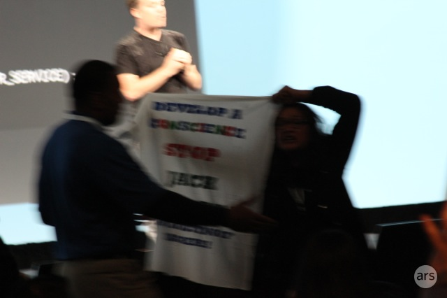 This blurred action shot is what happens when protesters unexpectedly disrupt a Google I/O keynote.