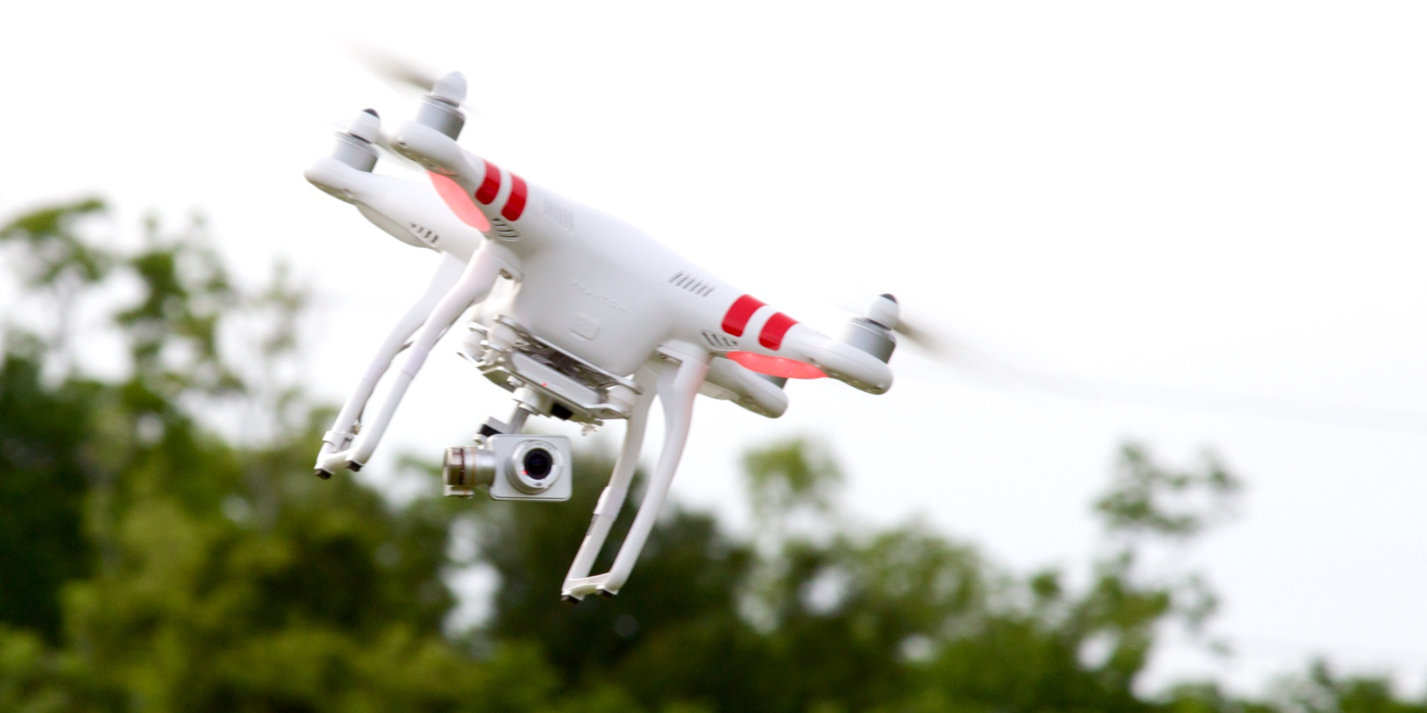 The DJI Phantom 2 Vision+ and its gimbal-stabilized camera, doin' its stabilization thing in flight.