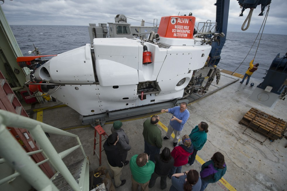 """Back on deck after his dive to the bottom of the Gulf of Mexico, Woods Hole Oceanographic Institution scientist Chris German is surrounded by eager scientists (and one journalist) as he describes what he saw and how the sub performed."""