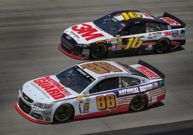 A pair of 2014 NASCAR Cars of Tomorrow. Dale Earnhardt Jr is in the Chevrolet-powered #88, Greg Biffle is in the Ford-powered #16.