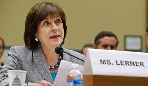 Former IRS official Lois Lerner giving testimony to a Congressional committee in 2013. The IRS says it can't find her e-mails from before 2011—but Justice Watch says they're in disaster recovery backups.