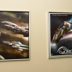 Beautifully rendered concept art posters adorn the hallways. Each of the game's ships has its own fictional manufacturer and its own in-game lore. At left are Musashi Industrial Freelancers; at right is one of the 300-series fighters.