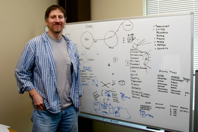 Persistent Universe Director Tony Zurovec with his whiteboard. Some of the different components used to construct missions are visible, along with other tidbits.