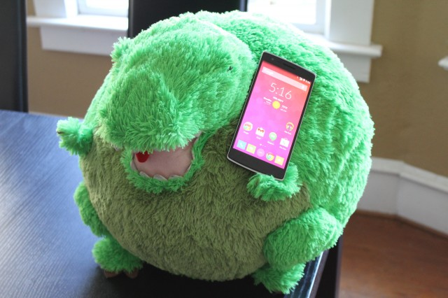 The OnePlus One may be giant in most hands, but perhaps less so in a T-Rex's!