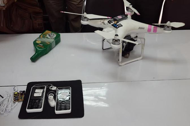 The captured DJI Phantom drone and its cargo, held by Thai prison authorities.