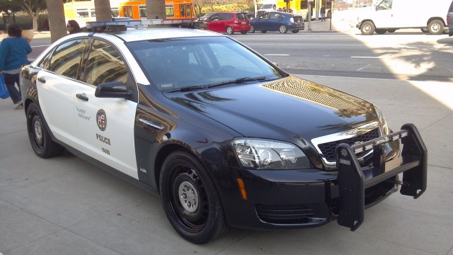 This LAPD patrol car is equipped with a LPR unit, mounted just in front of the light bar on the roof of the vehicle.