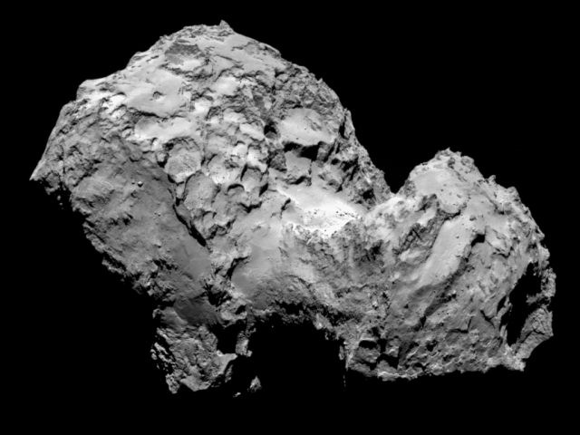 "Comet 67P/Churyumov-Gerasimenko, one of the main comets included in the study, taken by the Rosetta spacecraft's OSIRIS narrow-angle camera. A closeup look at the rubber duck's neck shows a strange landscape of smooth areas, ridges, and other features that hint at a complex past. Note that the comet has a ""bi-lobed"" shape."