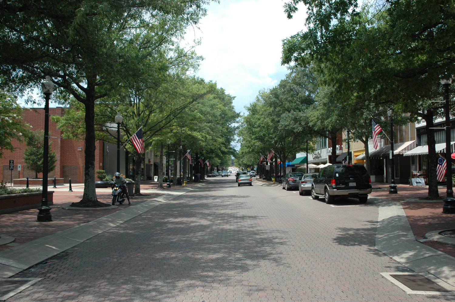 It took shop owners on the north (right) side of Hay Street in Fayetteville, North Carolina years to convince Time Warner Cable to provide them with Internet service, even though the south side of the street was wired.