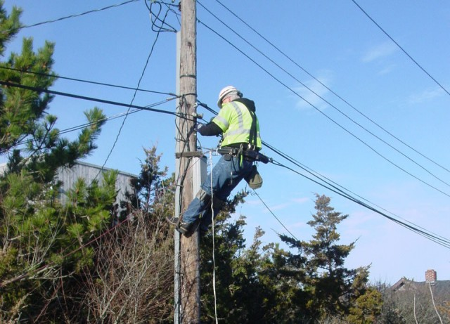 A Verizon technician positioning a fiber line near McBride's home.
