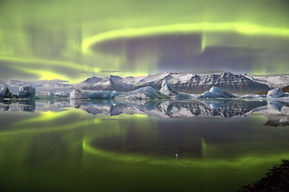 The overall winner, this photo of the aurora was taken in Iceland, land of the unpronounceable geography. In this case, you're looking at the Jökulsarlon lagoon, located in Vatnajökull National Park.