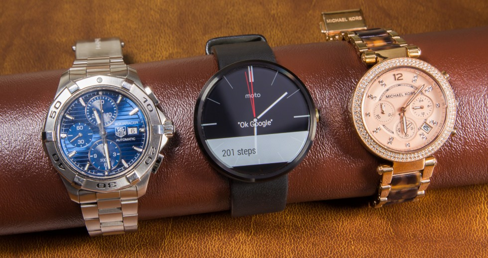 The Moto 360 (center) could almost pass for a real watch.