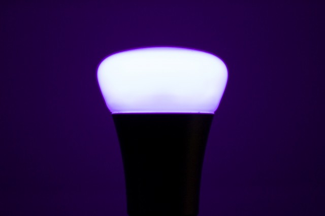 A Philips Hue bulb, strutting its purple stuff.