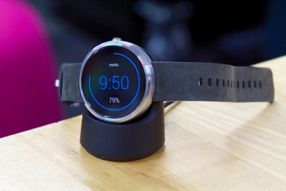 The Moto 360 on its wireless charging stand.
