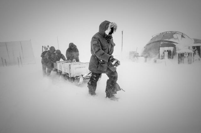 Researchers working at the site of a recent ice core (designated NEEM) in northern Greenland.