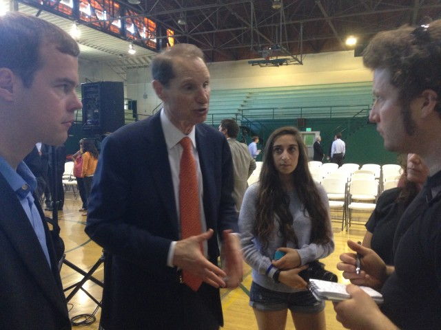 Sen. Ron Wyden (D-Ore.) spoke to reporters and students after his event Wednesday at his alma mater, Palo Alto High School.
