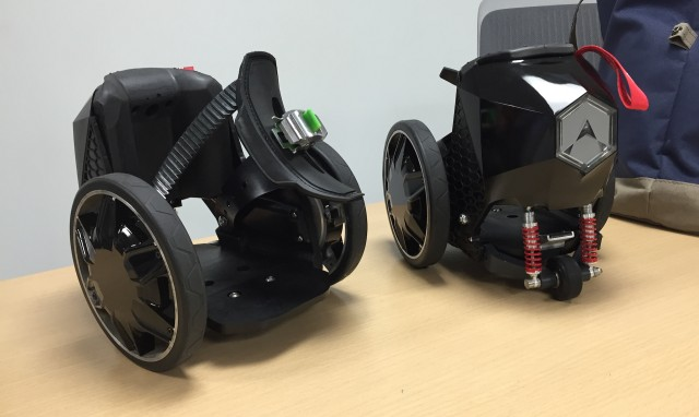 The front (left) and back (right) of RocketSkates, motorized chariots for your feet.