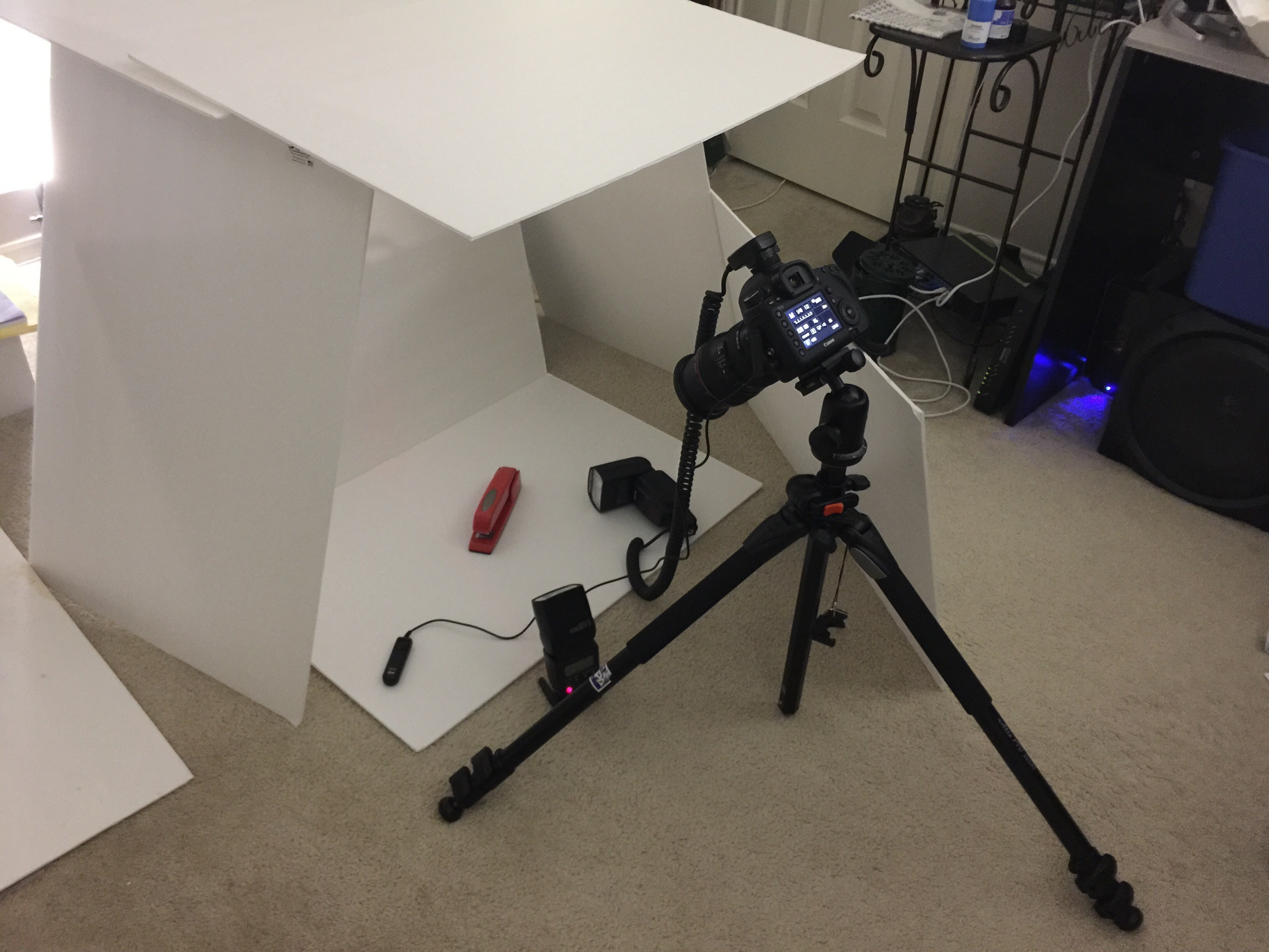 My make-shift product photography studio. This is generally what I do for any review product I photograph for Ars—build a light-bouncing fort of posterboard on the floor next to my desk and go to town. (Photo taken with the iPhone 6 Plus.)
