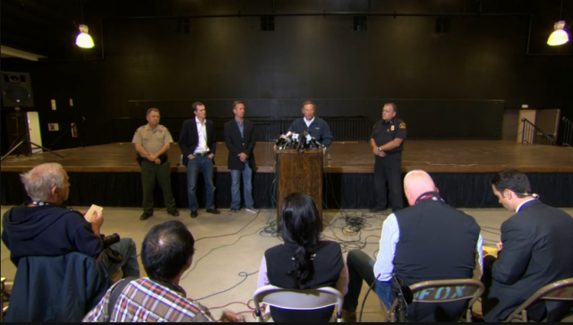 Today's press conference. From left to right, speakers are Kern County Sherriff Donny Youngblood, Virgin Galactic President George Whitesides, Scaled Composites President Kevin Mickey, Mojave Air and Space Port CEO Stuart Witt, and Kern County Fire Department Captain Brian Marshall.