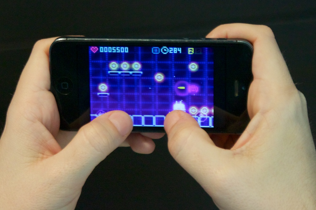 ...while playing on the iPhone 5 is much more cramped and causes your thumbs to block more of the action.