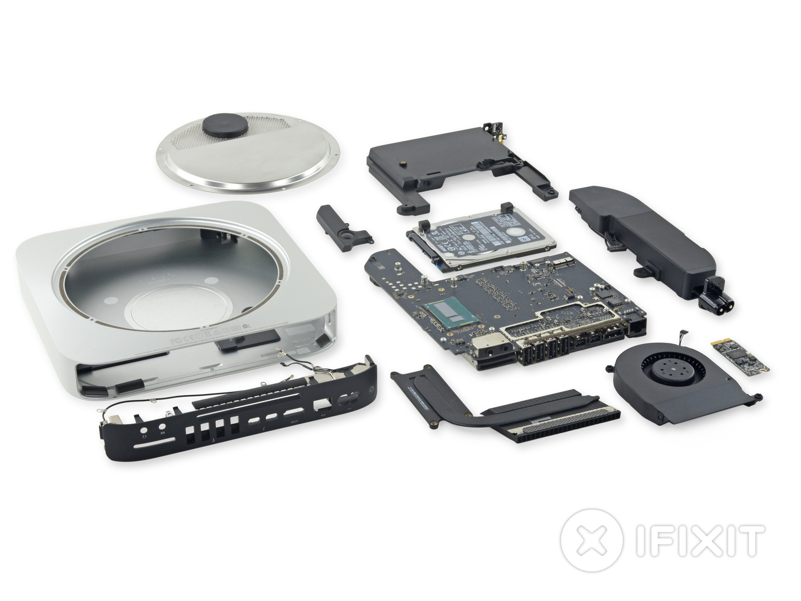 ifixit s 2014 mac mini teardown shows a sealed less upgradeable redesign ars technica. Black Bedroom Furniture Sets. Home Design Ideas