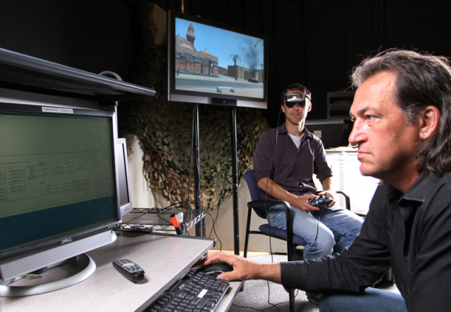 Dr. Skip Rizzo (right) monitors a patient as he use PTSD virtual reality immersion program Bravemind.