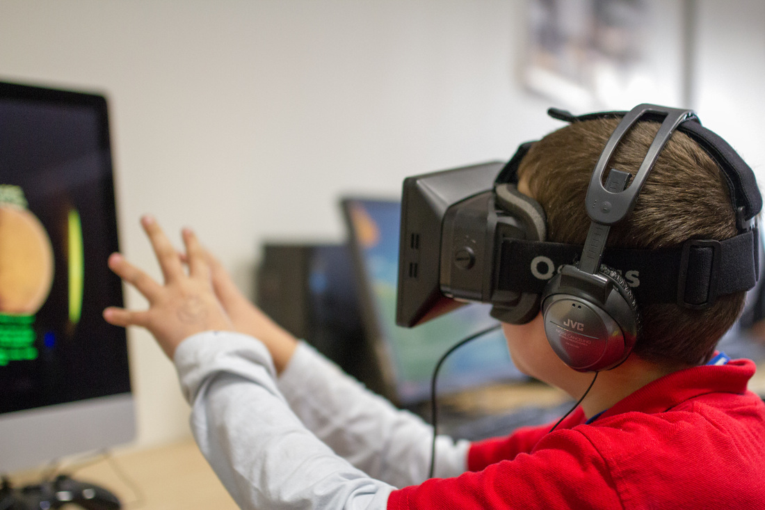 One of Mathieu Marunczyn's students reaches out while using the Oculus Rift to explore Titans of Space.