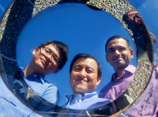 Stanford's Linxiao Zhu, Shanhui Fan, and Aaswath Raman, reflected in a prototype disk of their rooftop cooler.