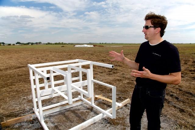 Markusic at the test site, explaining space.