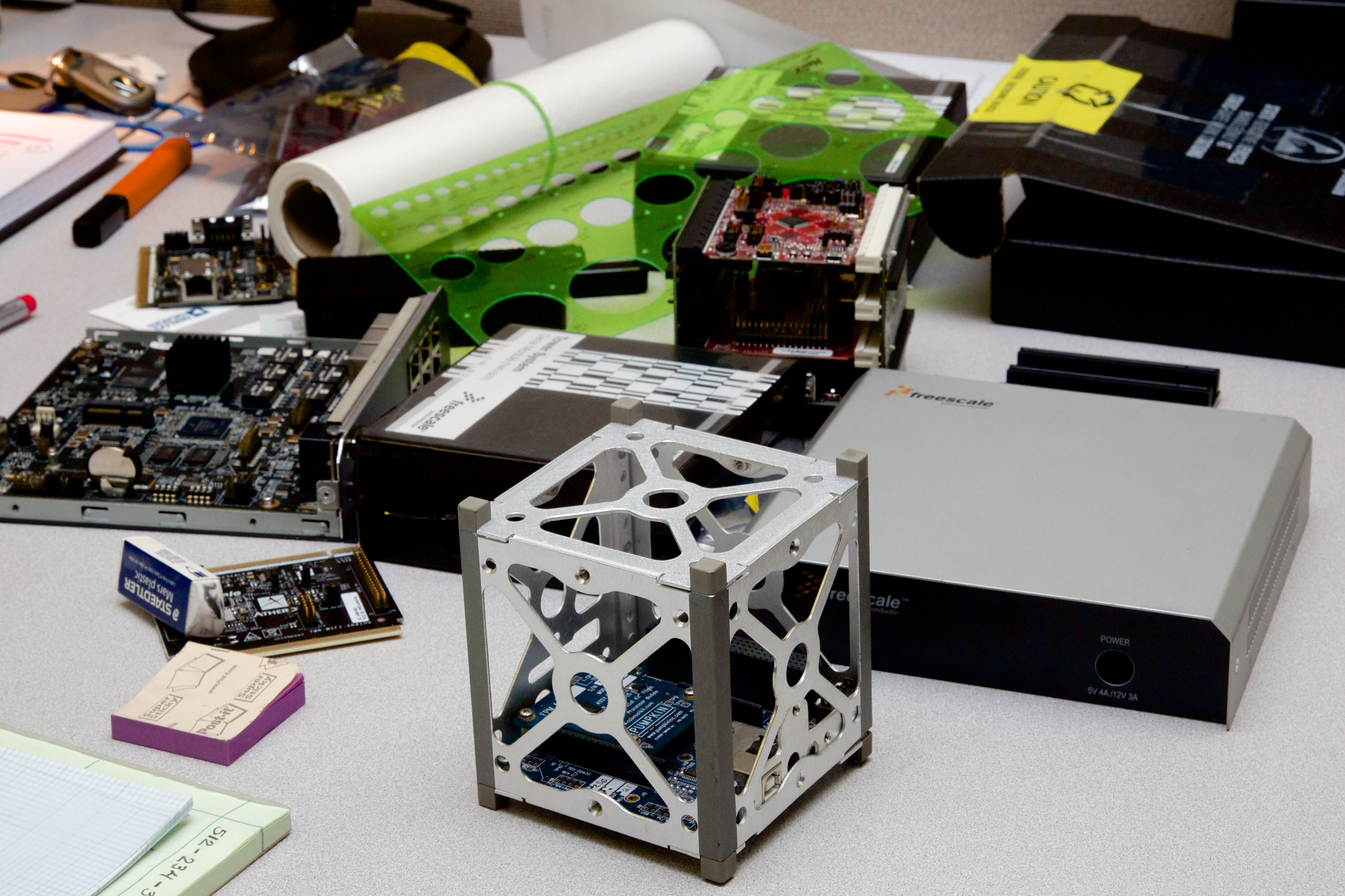 Cubesat model on CTO Shey Sabripour's desk in the Firefly offices.