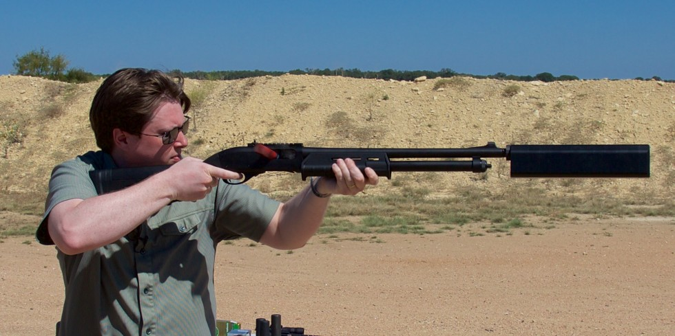Firing a Remington 870 tactical shotgun with SilencerCo's Salvo suppressor. Note lack of hearing protection.
