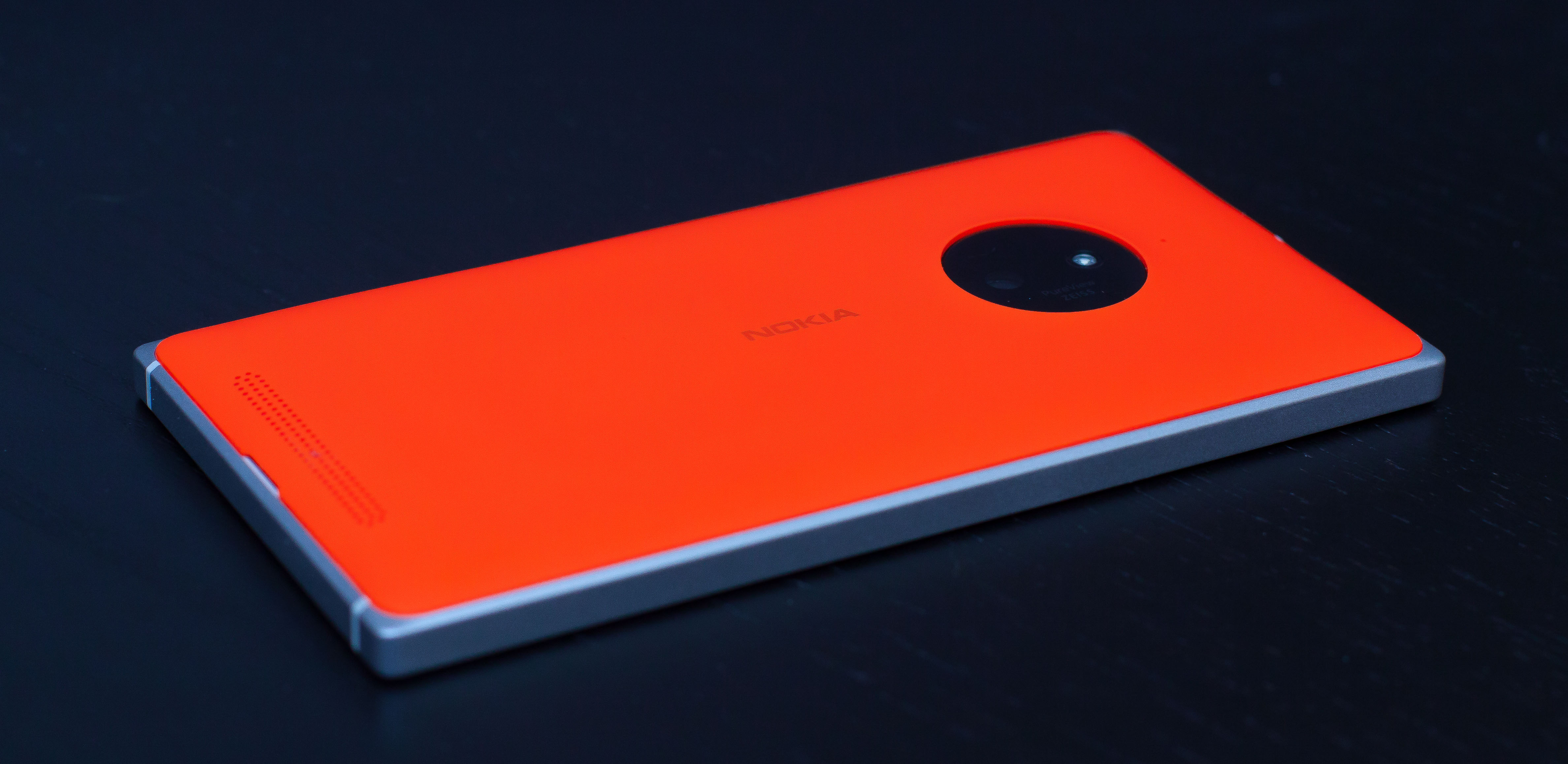 The Lumia 830. The orange part pops off, exposing the battery, SIM, and microSD slot, and it can be replaced if you want something a little less orange. Not that you would.