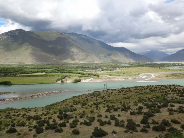 A broad, 4 kilometer-wide section of the Tsangpo River Valley. About 800 meters of sediment fills the valley here.