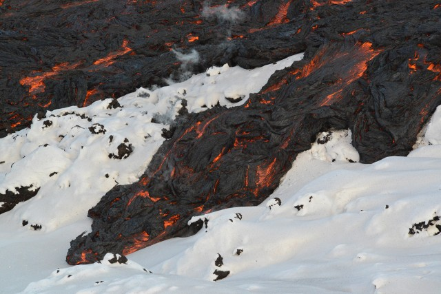 A bit of pahoehoe lava meets the Kamchatka snowpack.