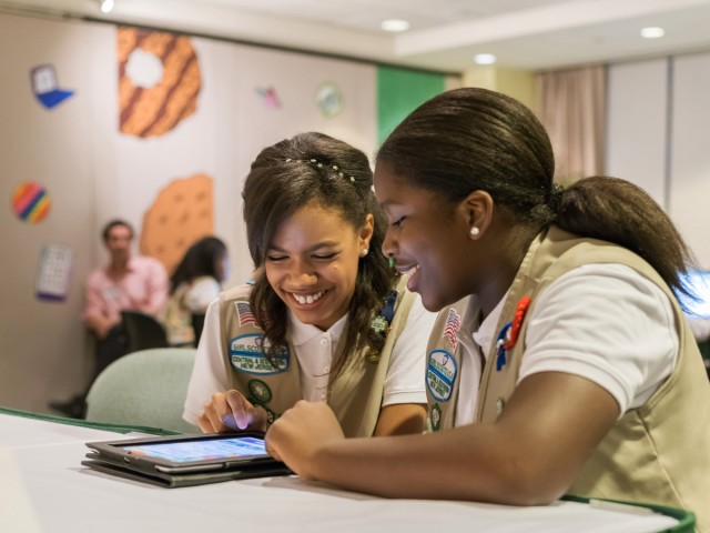 We assume this photo, provided to the press by the Girl Scouts of the USA, is showing two scouts testing the non-profit's new cookie sales app, as opposed to trolling their friends on Yik Yak.